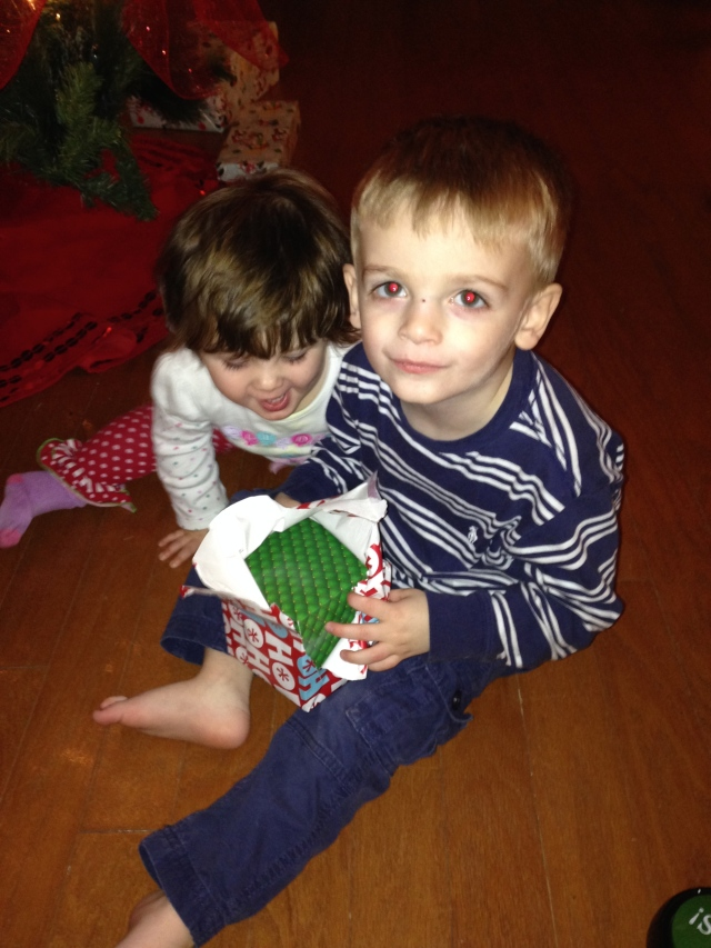 Maddox and Laney tearing into a gift that does not belong to them.